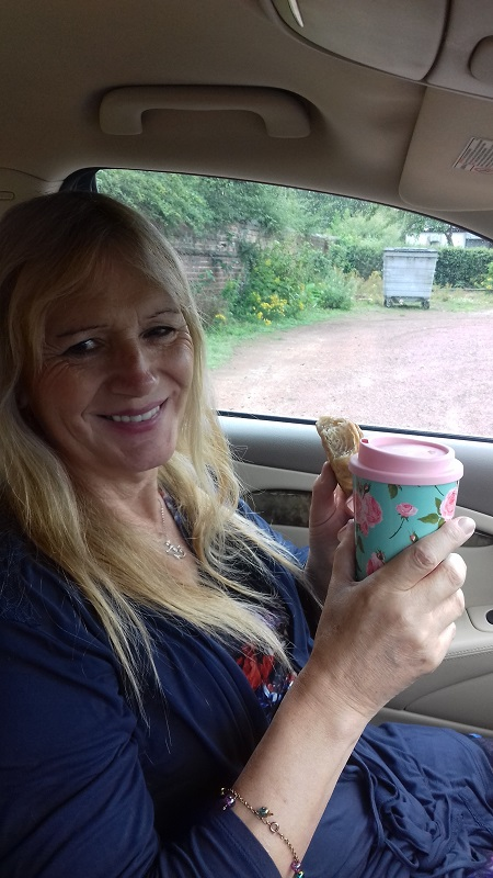 Lucy with coffee in car